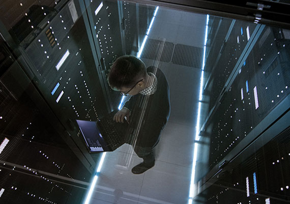 Picture of a man standing in front of a server rack